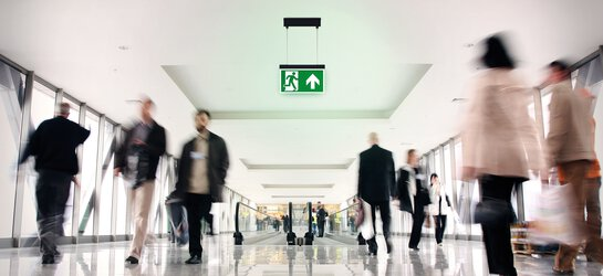 Interior view of a corridor in the airport with an emergency light