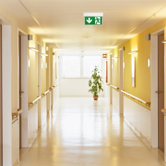 Interior view of a corridor in a hospital with an emergency light