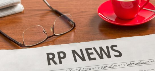 newspaper of RP News with a cup of coffee